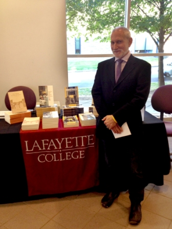Author and anthropologist Paul Stoller next to his new book.