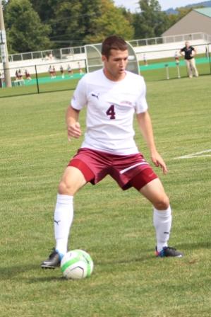 Bryan White '14 controls the ball.