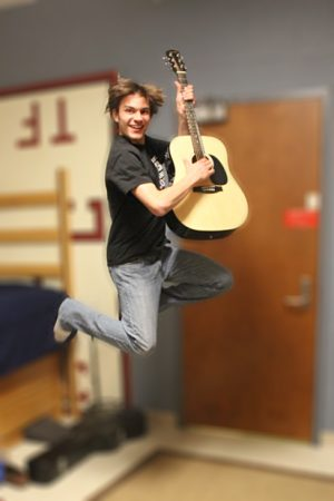 In addition to his track and classroom accolades, Tom Day '16 can play the guitar.