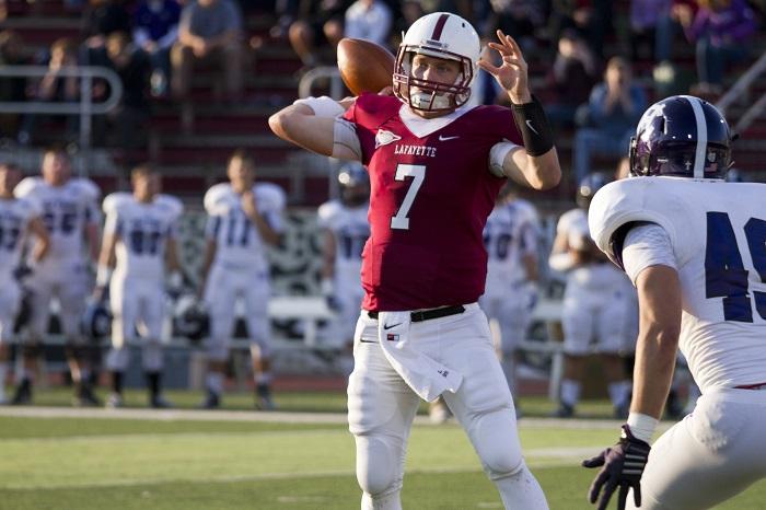Sophomore quarterback Drew Reed looks for an open target downfi el