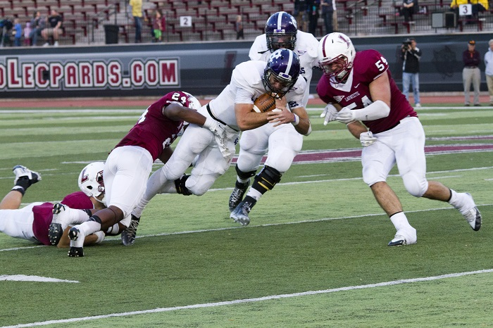 The Lafayette defense takes down Holy Cross's running back during the Homecoming game.  Holy Cross rushed for 291 yards on the day