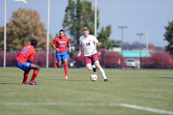Senior Tom McCutcheon attempts to dribble past the defender for a break- away against Bucknell.  [Photo Courtesy of Lafayette Athletic Communications]