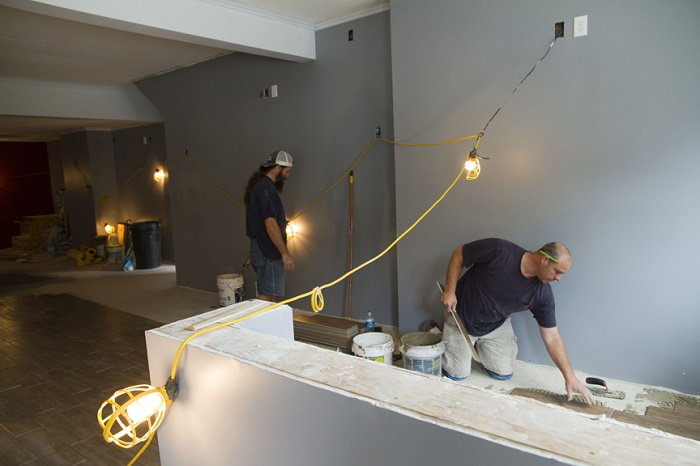 A carpenter works on renovations of College Hill Tavern.