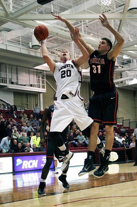 Senior Dan Trist eludes a Princeton defender as he puts up a shot on Nov. 19. [Photo Courtesy of Austin Drucker '17]