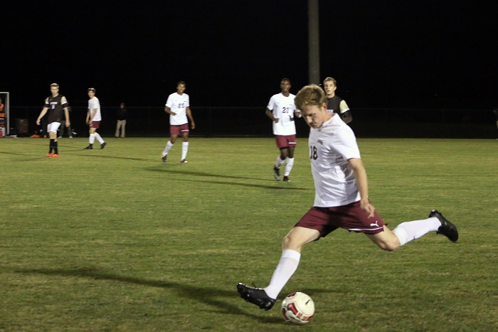 [Photo Courtesy of Austin Drucker '17] Senior Tom McCutcheon attempts to dribble past the defender for a break- away in the team's latest game