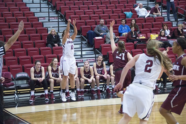 Jamie O'Hare runs the pick and roll with teammate Ashley Lutz