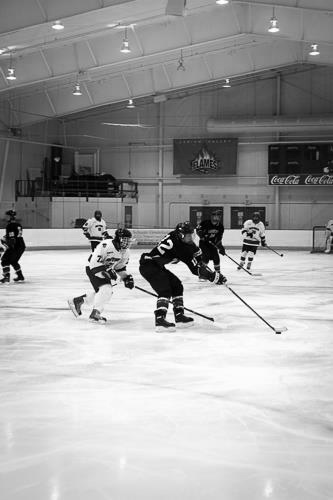 Lafayette player looks to clear the puck down the ice. [Photo Courtesy of Facebook]
