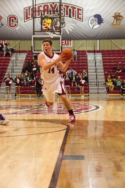 Junior Bryce Scott drives down a lane against the Holy Cross Crusaders.