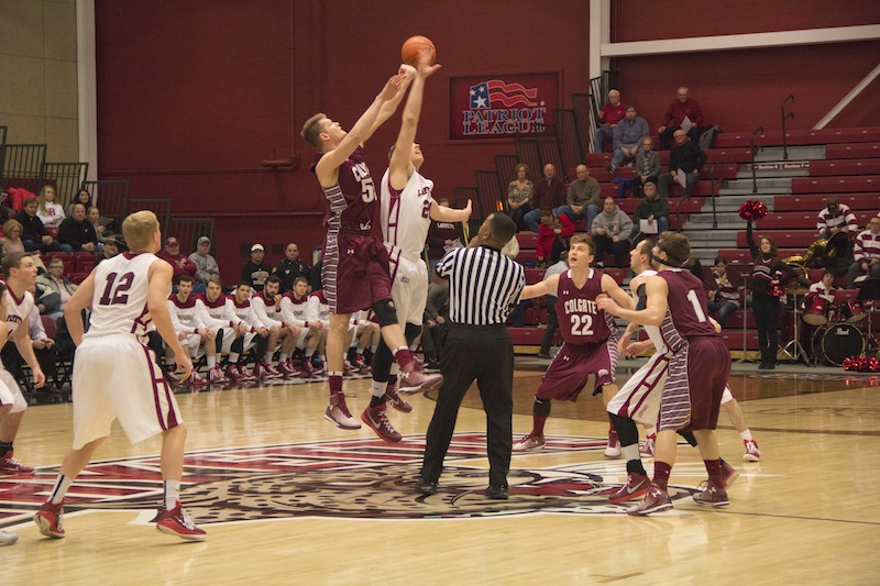 Senior Dan Trist meets the Colgate center at half court for tip-off [Photo by Christie Behot '16]