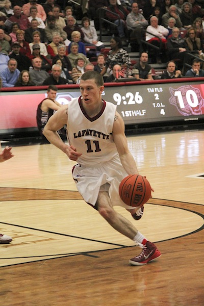 Sophomore Nick Linder dribbles into the paint for a lay-up.[Photo by Christie Behot '16]