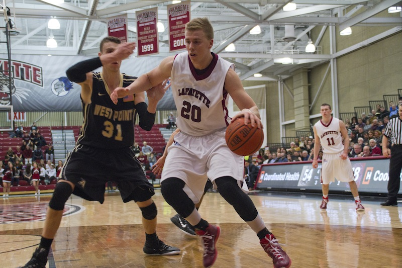Senior center Dan Trist posts up the Army center en route to 24 points on Senior Day. [Photo by Hana Isihara '17]