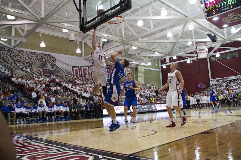 Nick Lindner drives to the basket for a layup against American. [Photo by Hana Isihara '17]
