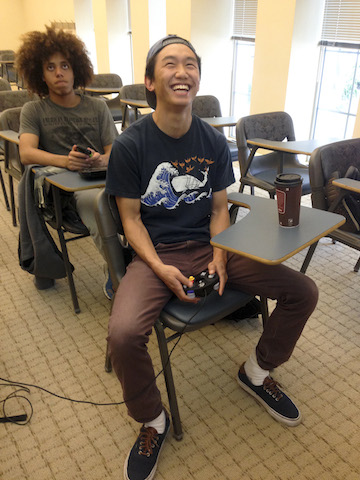Eugene Chung '15 laughing after playing a round of Smash Bros. [Photo by Elizabeth Lucy '15]