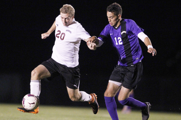 Todd Forrester '16 escapes an Albany defender. [Photo courtesy of Athletic Communications]