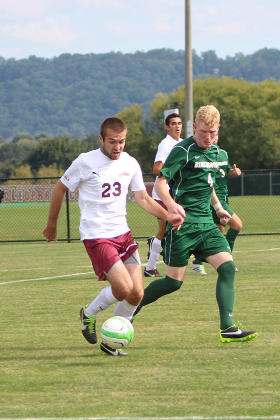 Senior Chandler Fraser-Pauls  pushes the attack at Metzgar Field against Binghamton University.