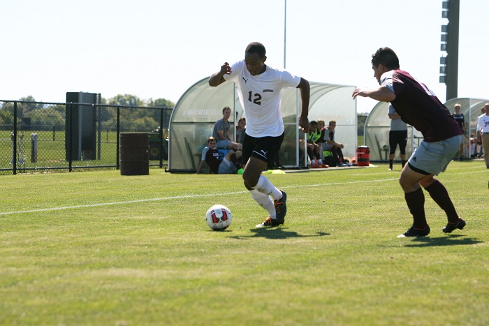 Junior Quentin Anson cuts up the field and looks to pass the ball to a teammate.