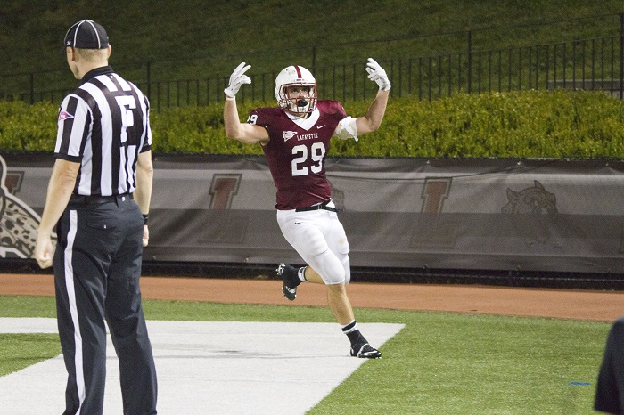 Photo by Hana Isihara '17 Senior Running Back Ross Scheuerman pumps up the crowd after a score against Wagner.