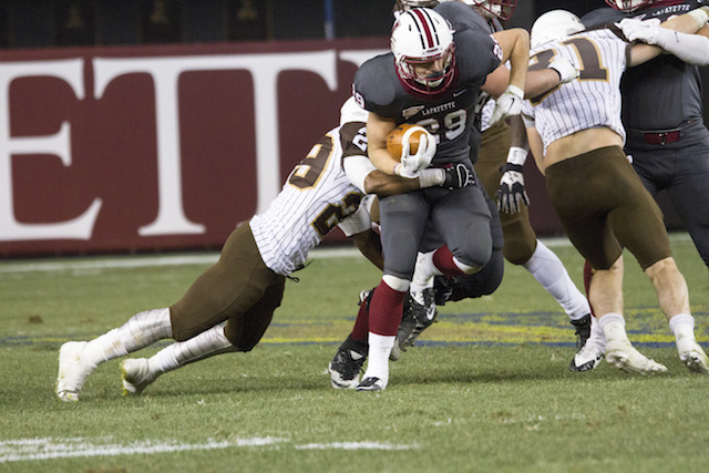 Senior Ross Scheuerman breaks free of a Lehigh defender out of the backfield. [Photo By Hana Isihara '17]