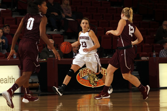Jamie O'Hare '16 dribbles down the court. [Photo courtesy of Athletics]