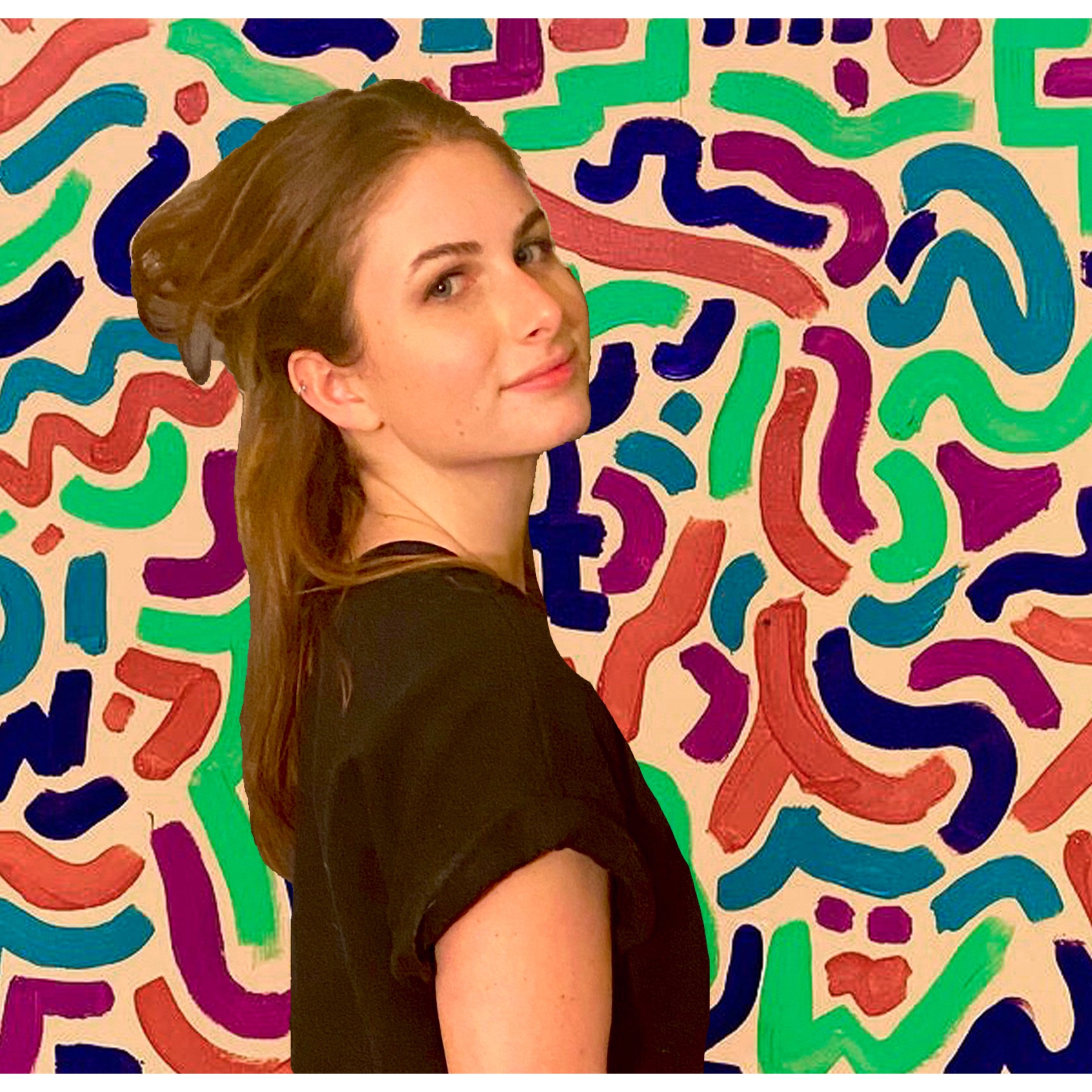 Gwen Goldman standing in front of a background full of colorful lines.