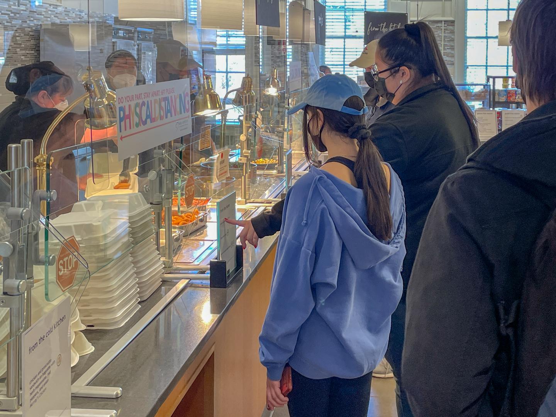 Two students looking at a menu at Marquis.